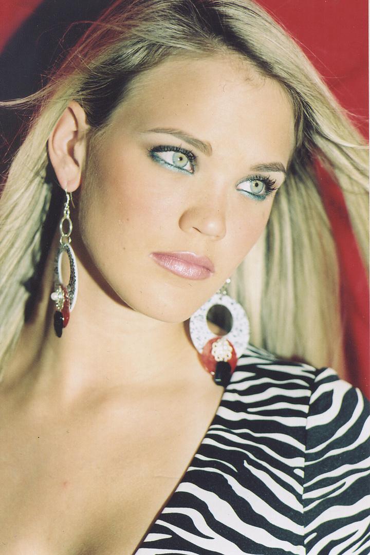 Haley wears white, red, black earrings