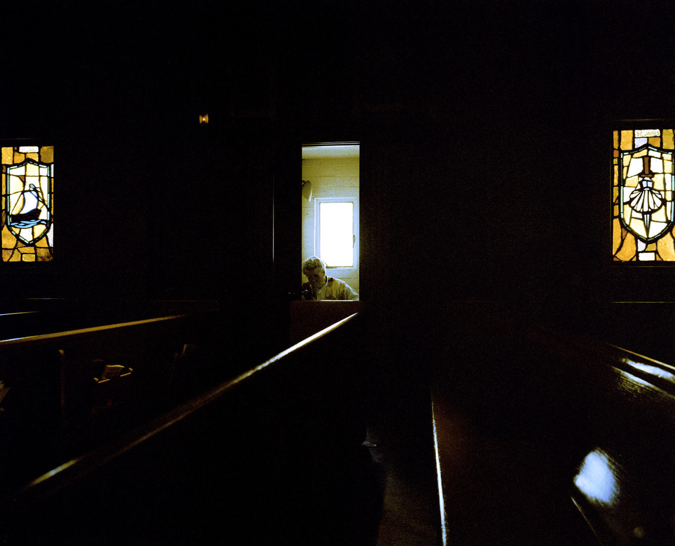Priest in confessional, San Francisco