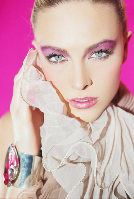 "COURTNEY, Hollywood actress, model wears a 2"" silver cuff with a pink stone."