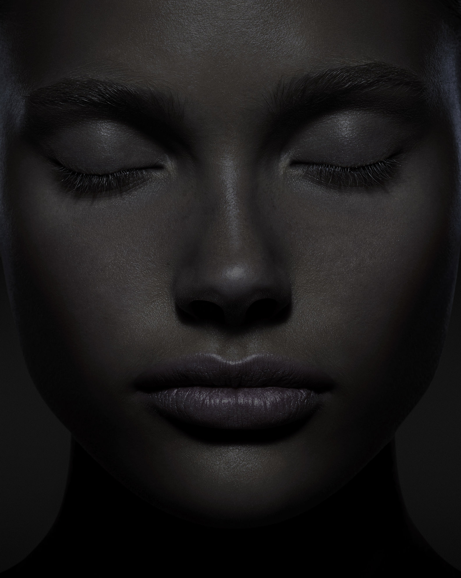 Dark female portrait with closed eyes