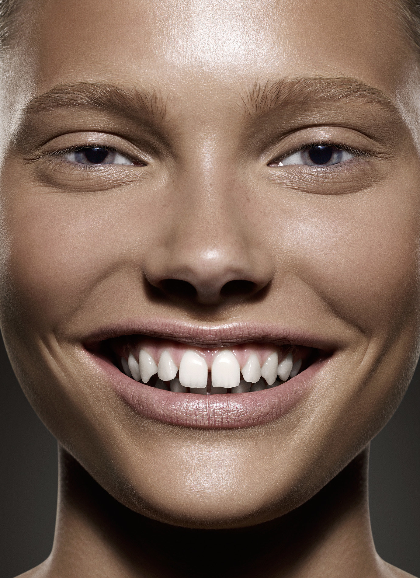 0012_Close up beauty portrait of smiling gap toothed young woman by photographer Kenneth Rimm.jpg