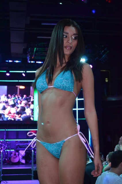 Dawn Donning stars in the TASTE OF COLLINS  International swimsuit fashion show.