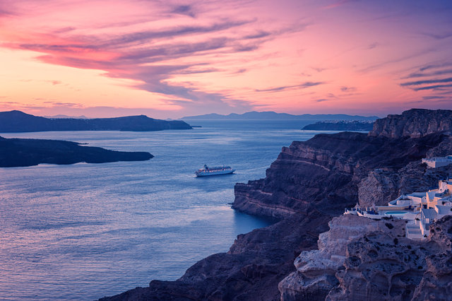 Cruiseship in Santorini Greece around sunset Getty Hi Res.jpg