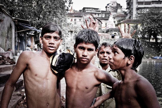 Young kids hanging out at an Indian Temple, Mumbai