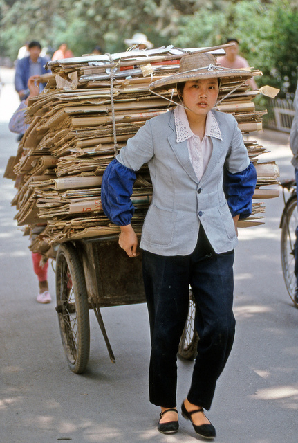 Girl carry cardboard China 1-03.jpg