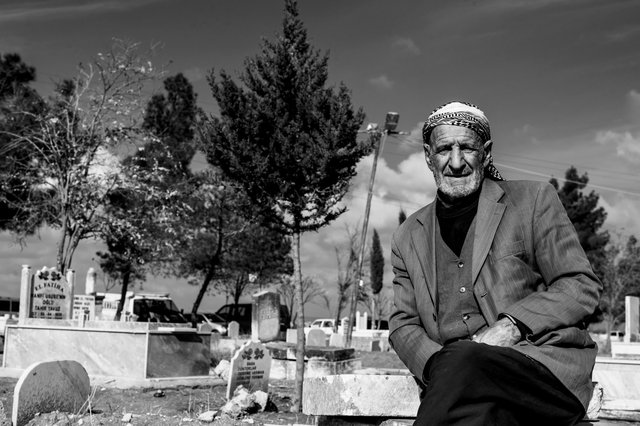 Man in the cemetery, Mesher, Turkish Kurdistan 2014
