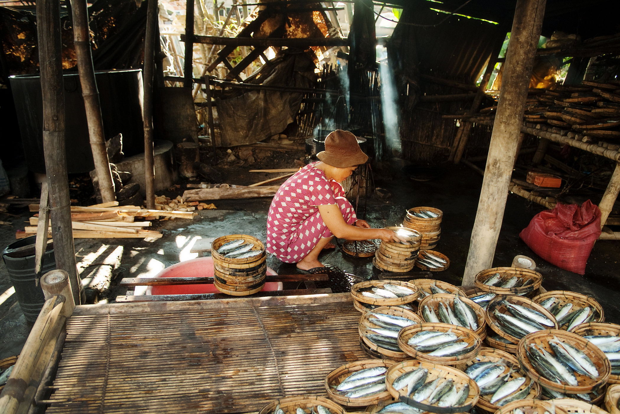 Villager Drying Fish