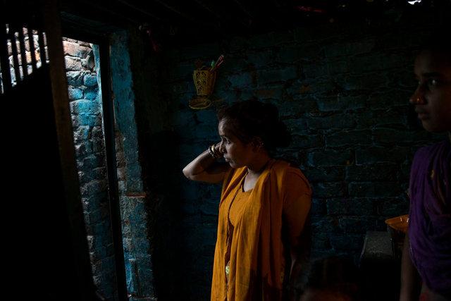 Meena, un'ex manual scavenger che oggi conduce un riscio' taxi a Nand Nagri, Neh Delhi