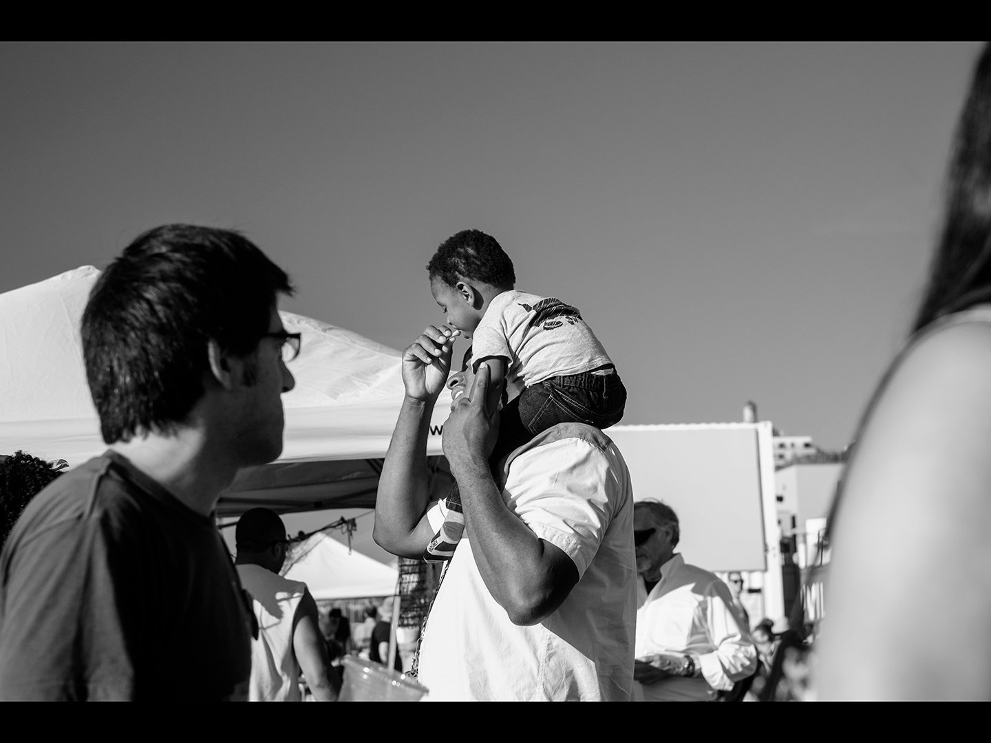 Father and Son Eat French Fries Photoville BW (Viewbook).jpg
