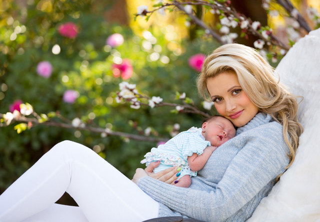 HOLLY MADISON WITH HER DAUGHTER RAINBOW at 1 week old