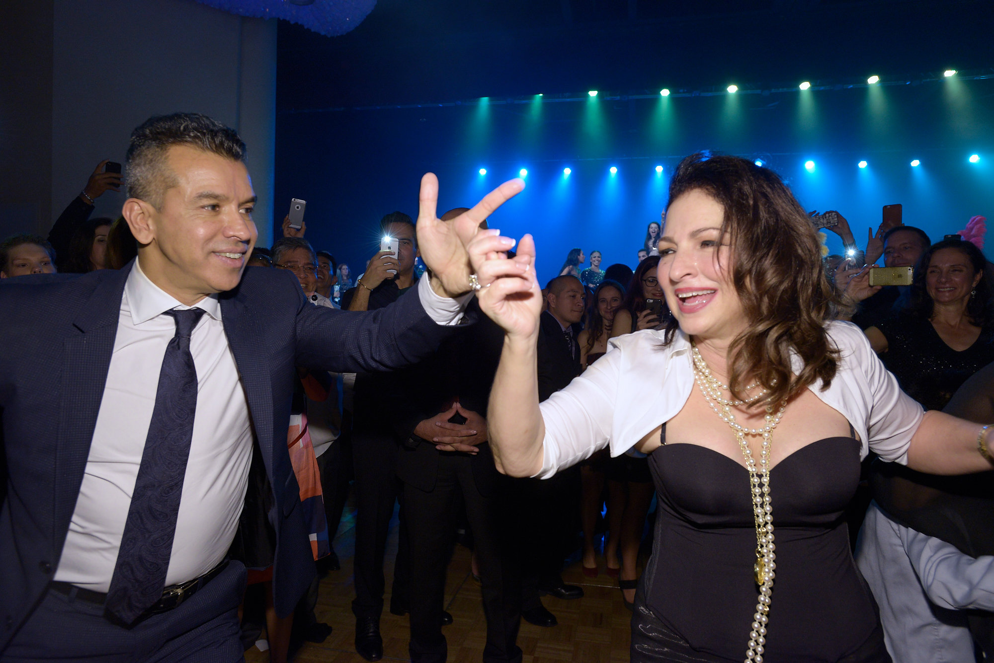 Sergio Trujillo twirls Gloria Estefan at the On Your Feet opening party