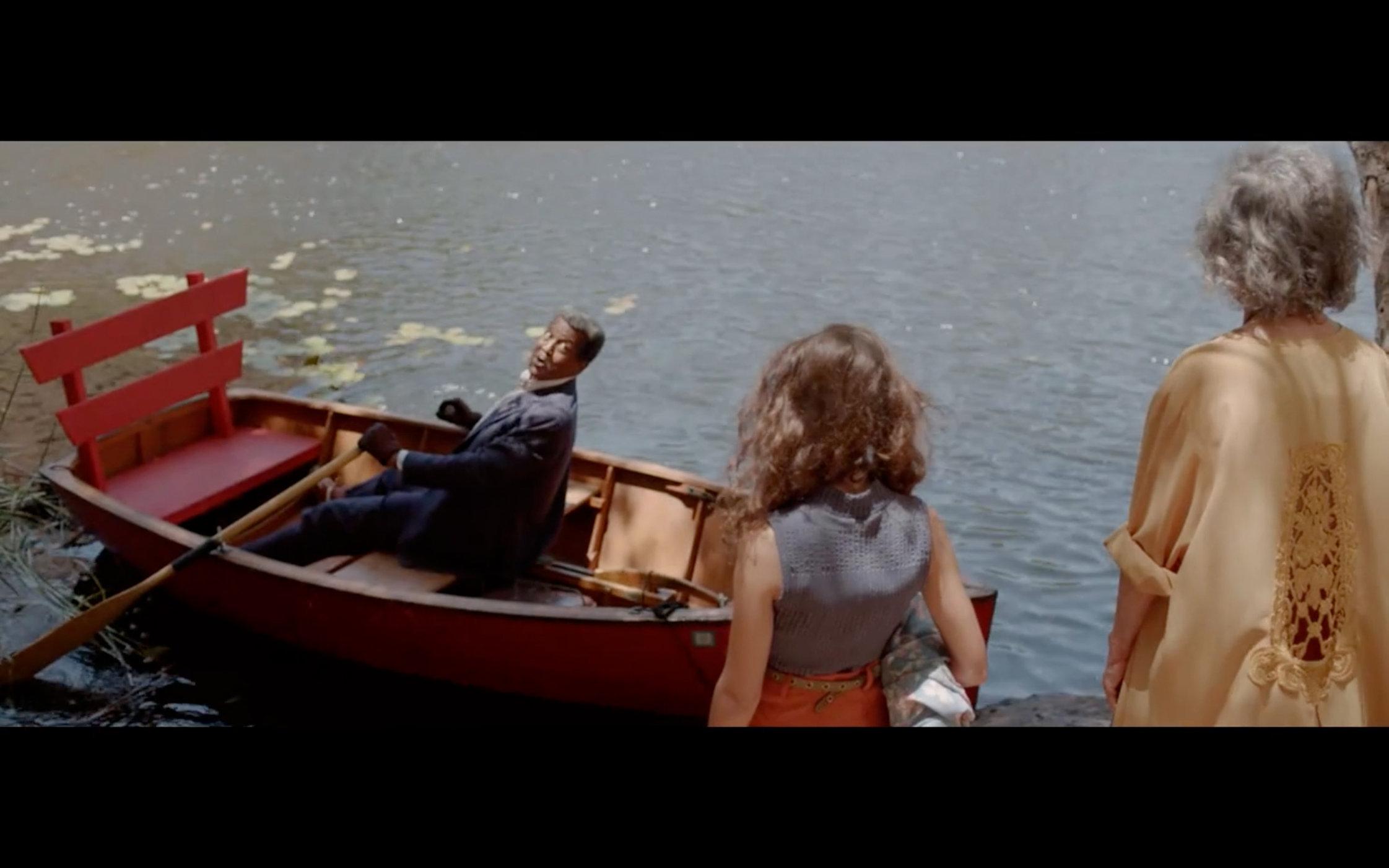 Edward greeting ladies in boat.jpg