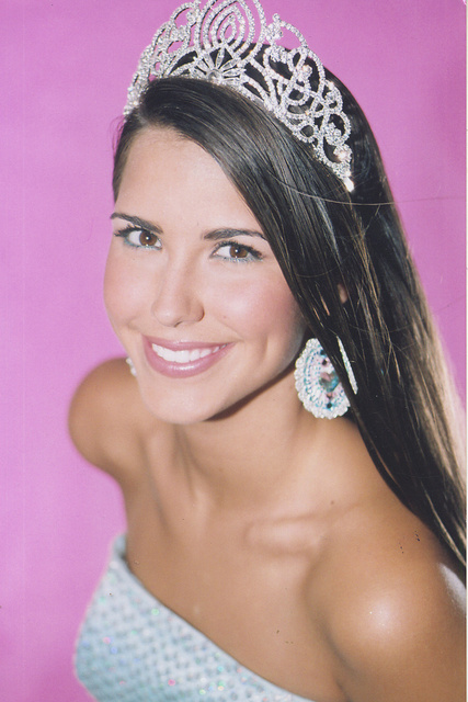 BRITTANY PJETRAG- MISS SC TEEN USA is wearing round silver disk with clear and ab stones.
