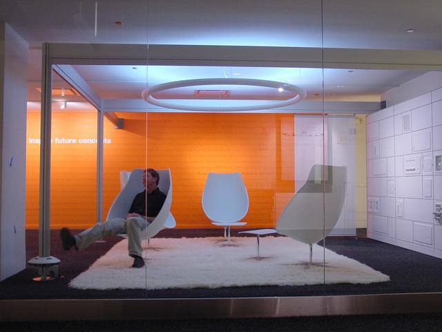 Light Lounge chair and ottoman.