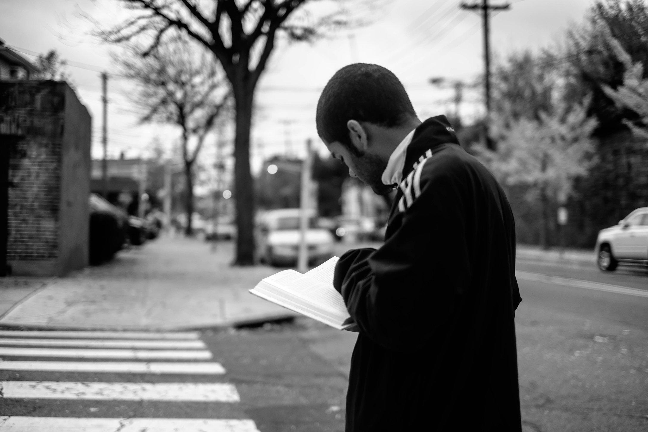 Youngmanreadsbookonstreet.jpg