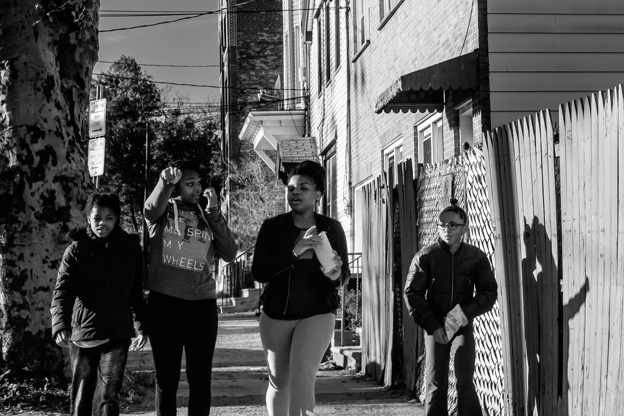 Four young girls walk down the street in Jersey City Heights.jpg