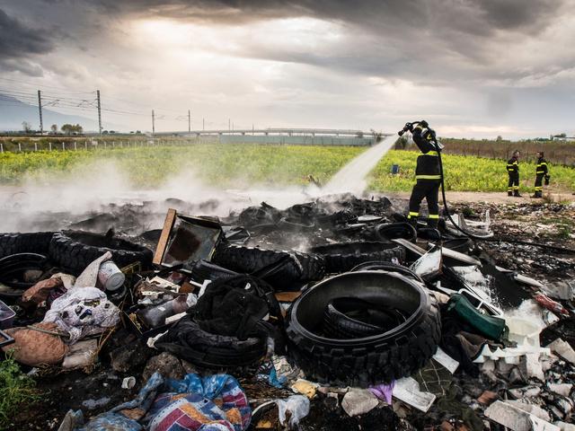 29.Piles of burnt truck tires.
