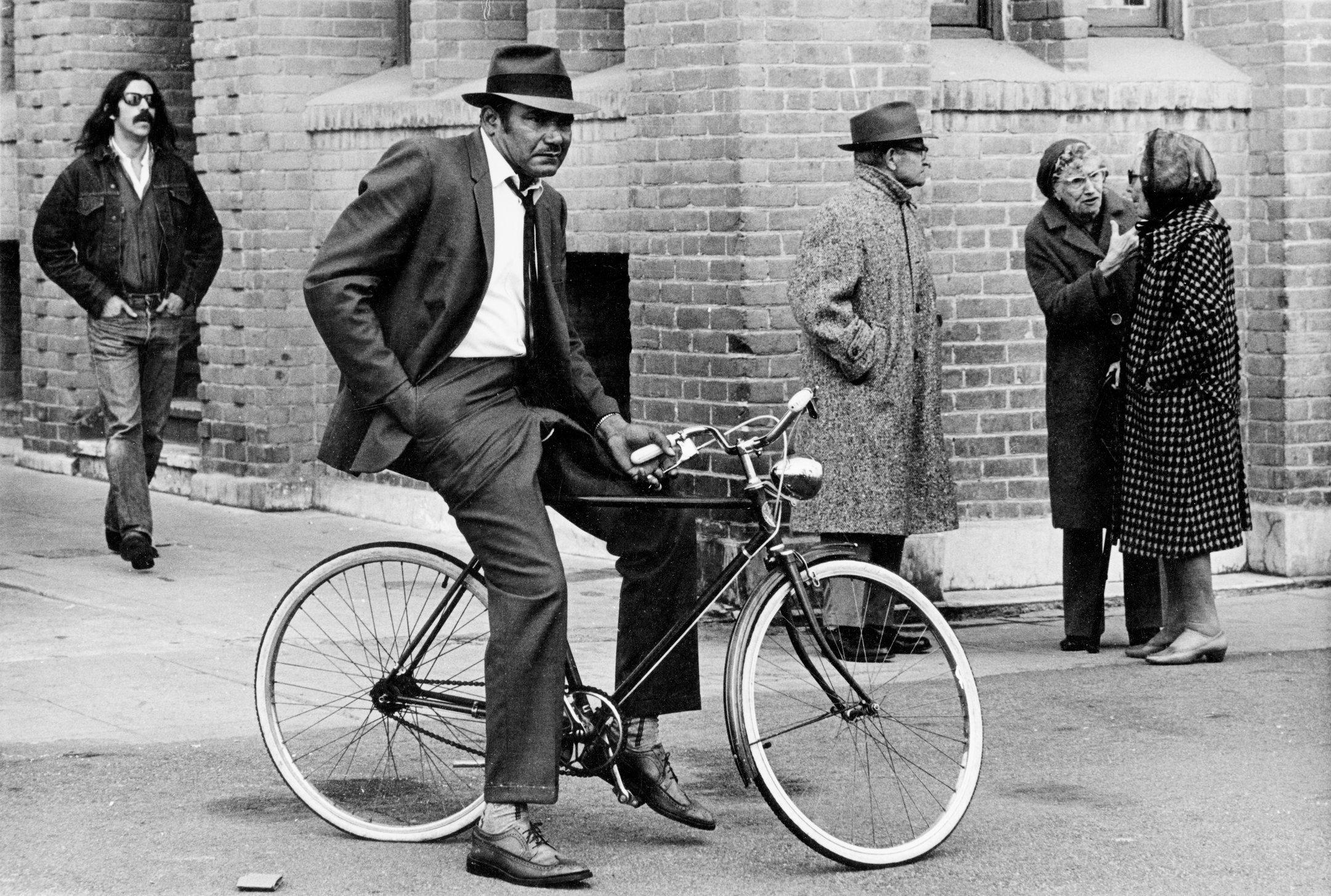 Venice boardwalk man on bike.jpg