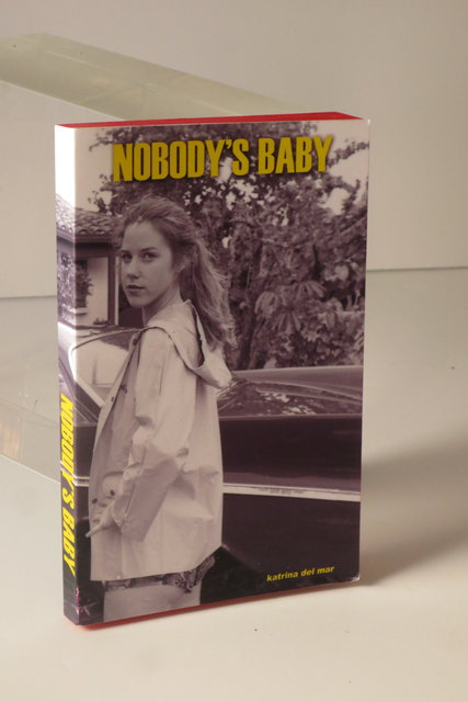 Nobody's Baby_Katrina del Mar_4.5x6x.75in handmade book_2013   45a_Katrina del Mar_Nobodys Baby_backview_4.5x6x.75in handmade paperback book_2013_Katrina del Mar paperbacks (selection of four hand made one of a kind paperback books in a case)