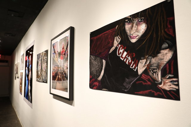 Installation view: Natalya in fishnets and clash t shirt, 2016, Oil Pastel on black velvet paper, 20 x 30 in.