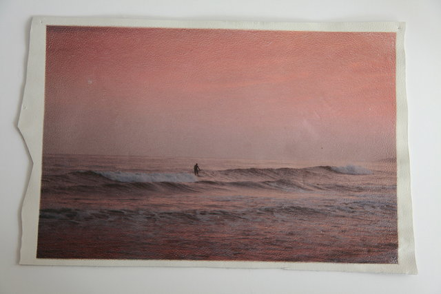 Katrina del Mar: Twilight Surf, Ditch Plains.  12 x 18 in archival pigment print on white leather