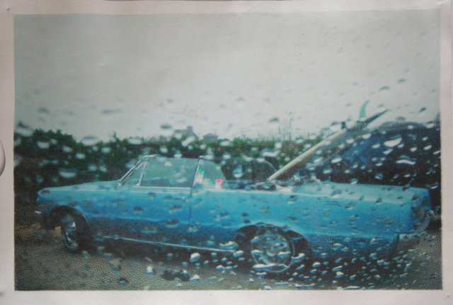 """Katrina del Mar: Blue Cadillac at Ditch Plains lot 12x18"""" archival pigment print on white leather"""