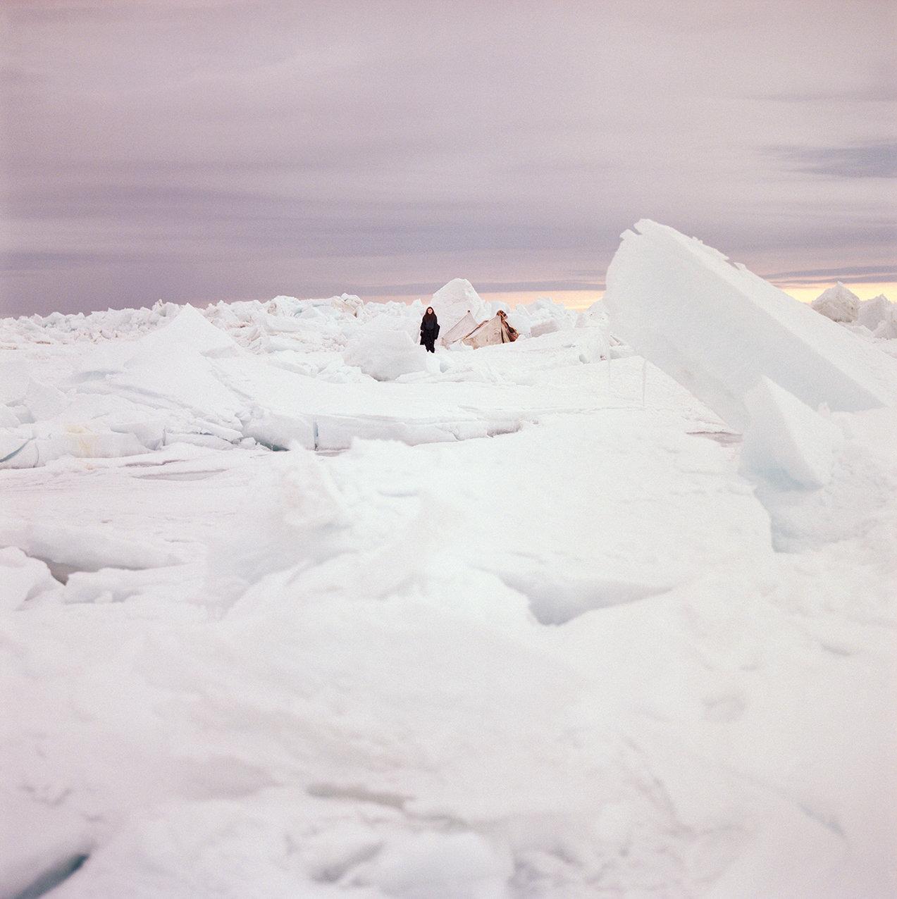 Nichole dwarfed by jagged ice, 2017