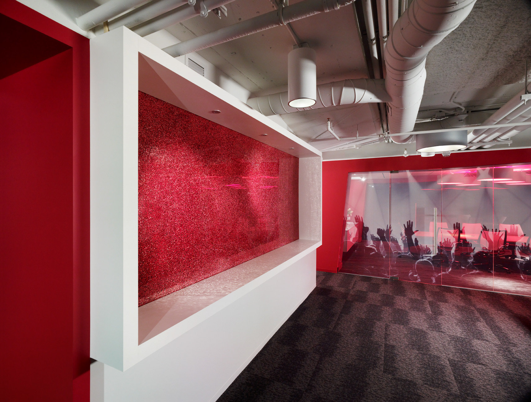 Open space with conference room wrapped with photo image.