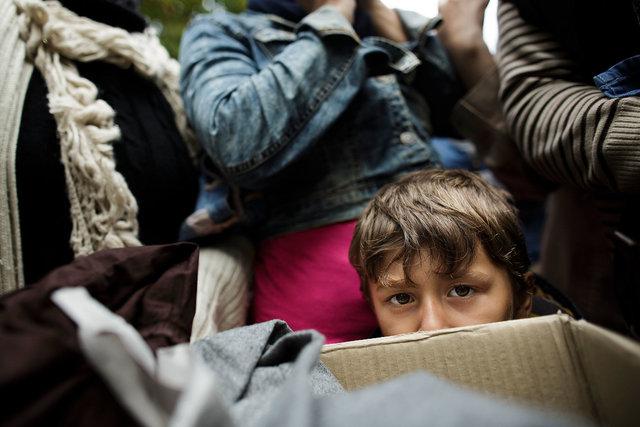 577314365CK006_Migrants_Con.JPG