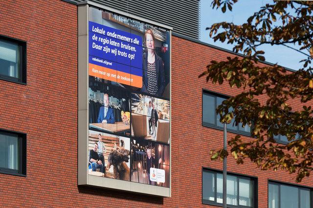 Portretserie lokale ondernemers op gevel Rabobank Breda