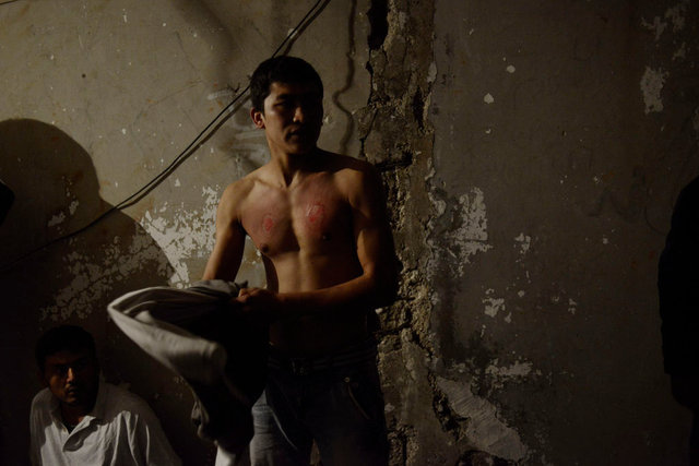 Mahdi Mohseni, 17, wears his chest after he mourns for the Day of Ashura. He has slashed his chest w