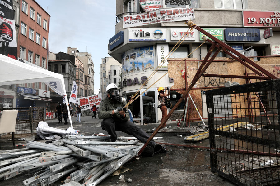 A protester pulls back the cord on a makeshift slingshot in Taksim square in Istanbul.