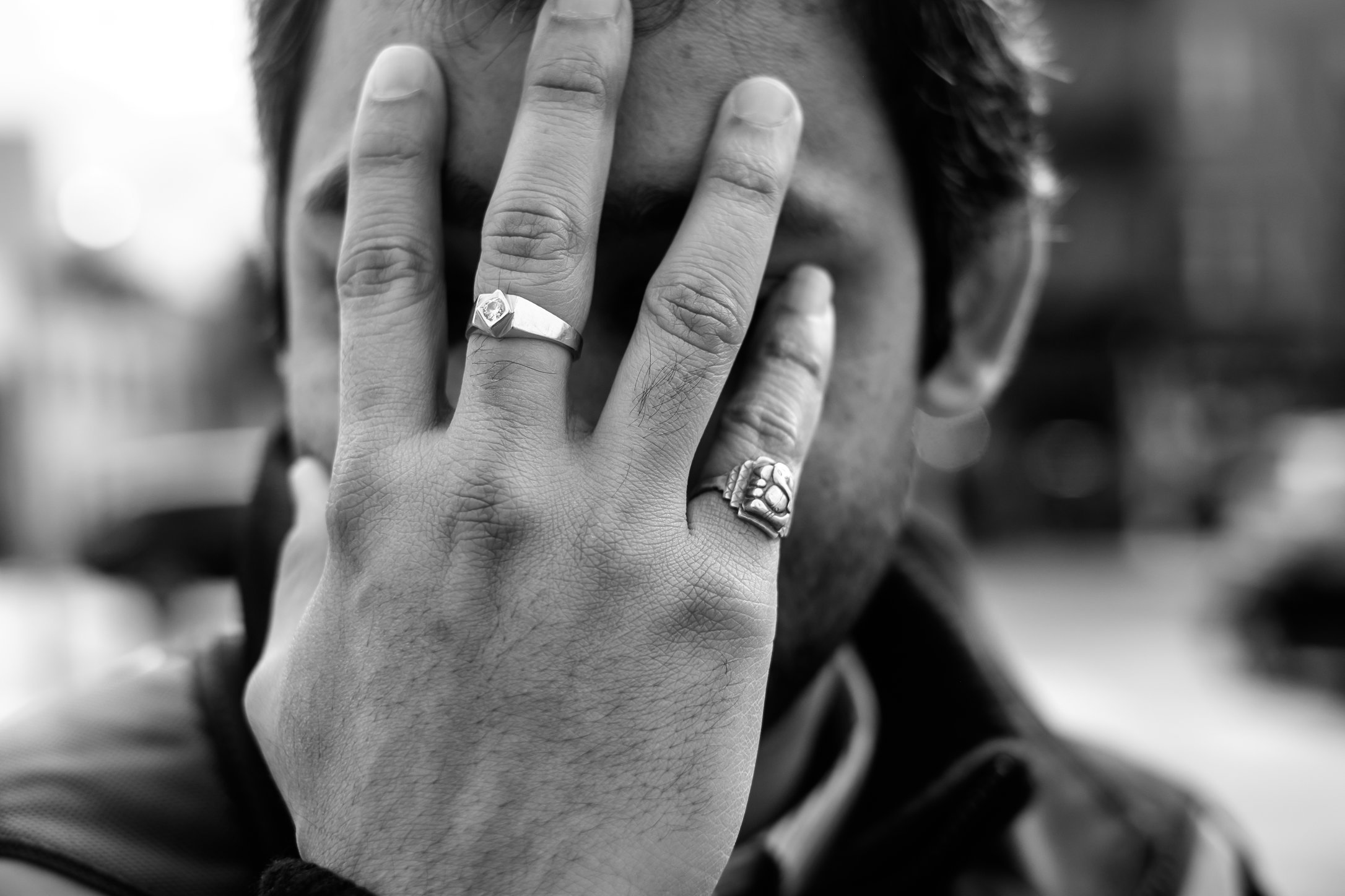 Man with Pinky ring and hand over his face.jpg