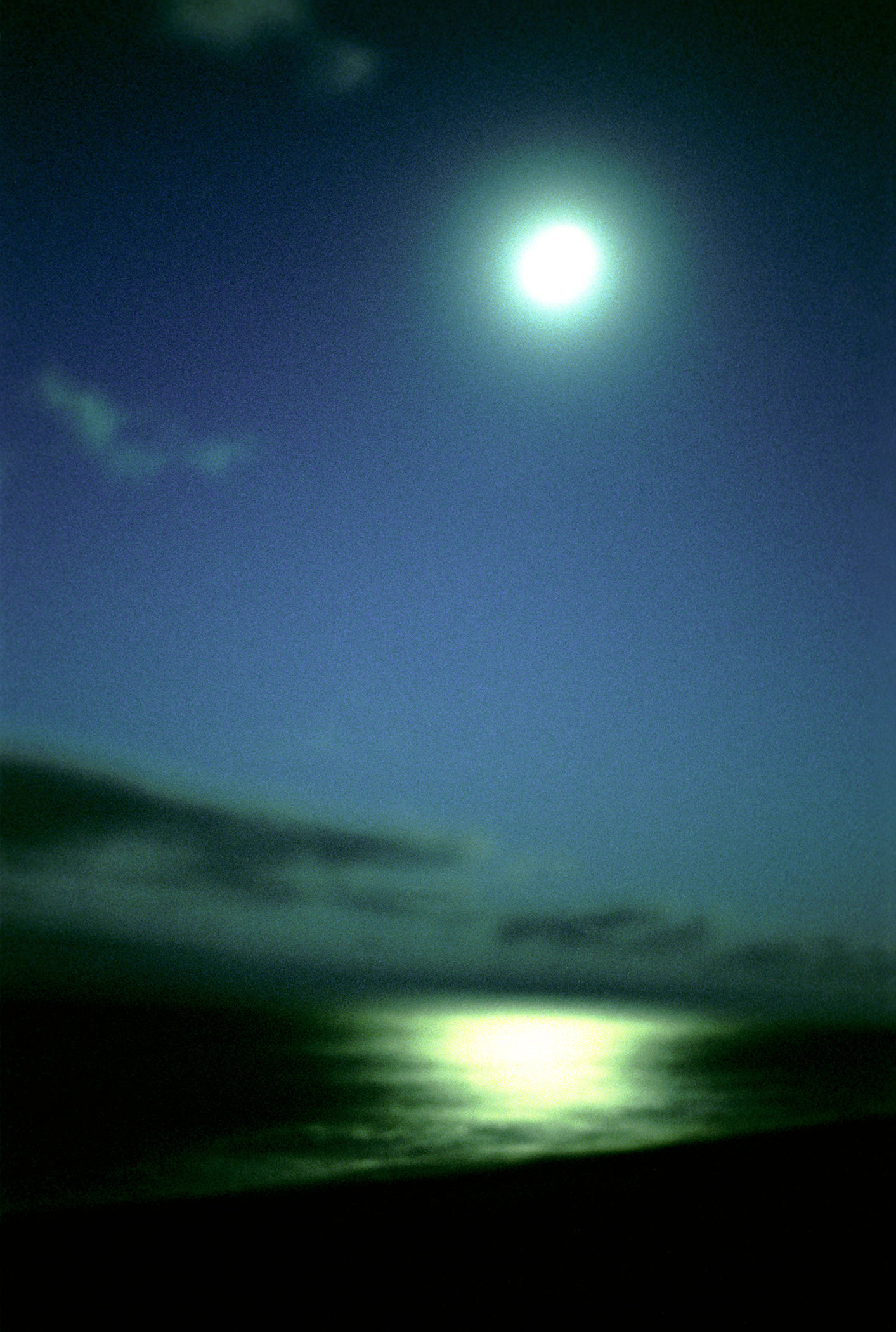 Turquoise Moon Over The Sea