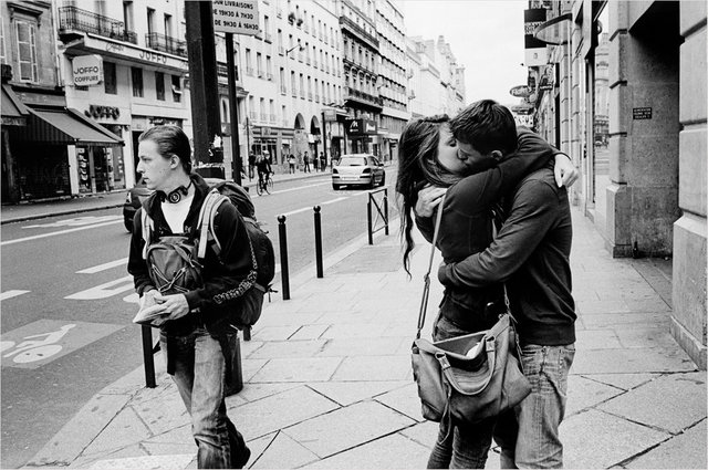 A couple kisses in front of the Saint Lazare station, Paris 2015