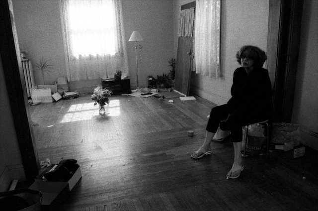 My mother in the living room, during a move to Houston.