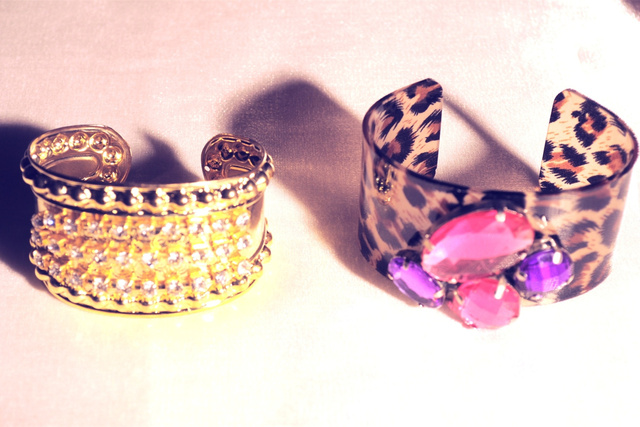 GOLD AND LEOPARD CUFFS with colored stones.