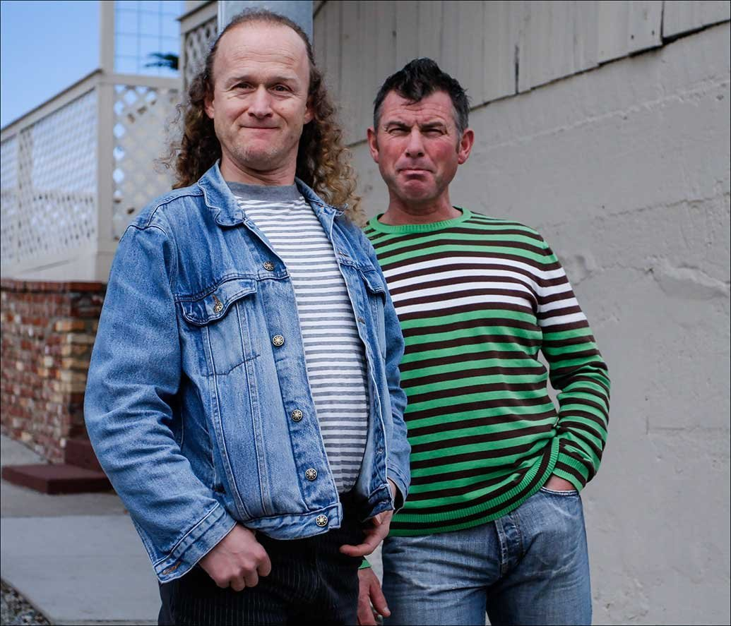 Men in Striped Pullovers