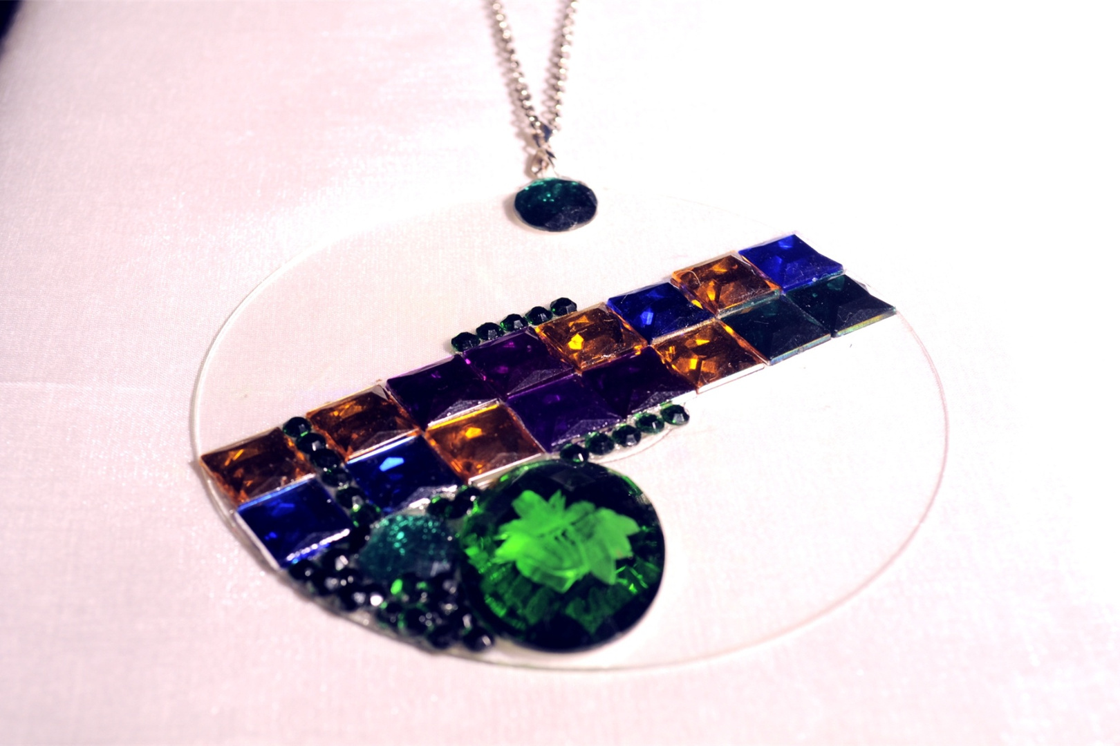 CLEAR DVD NECKLACE with colored stones added.