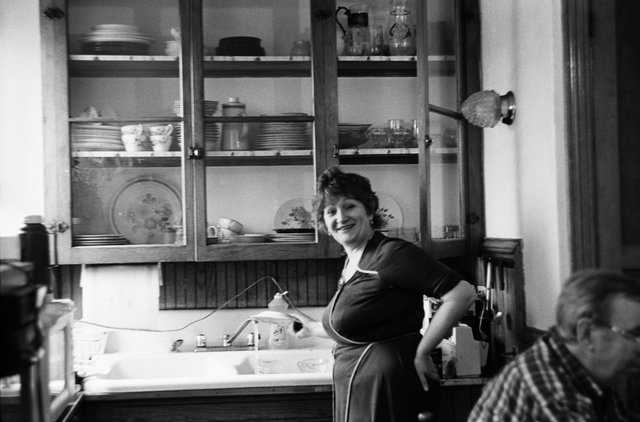 My aunt in the kitchen of her family's first apartment in America.