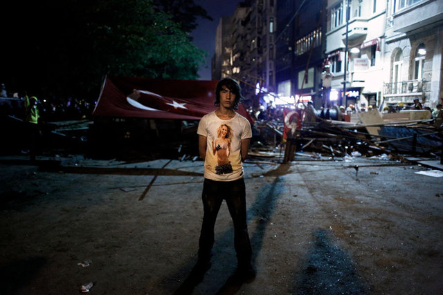 A protester stands in front of a makeshift barricade at Gezi park in Istanbul.