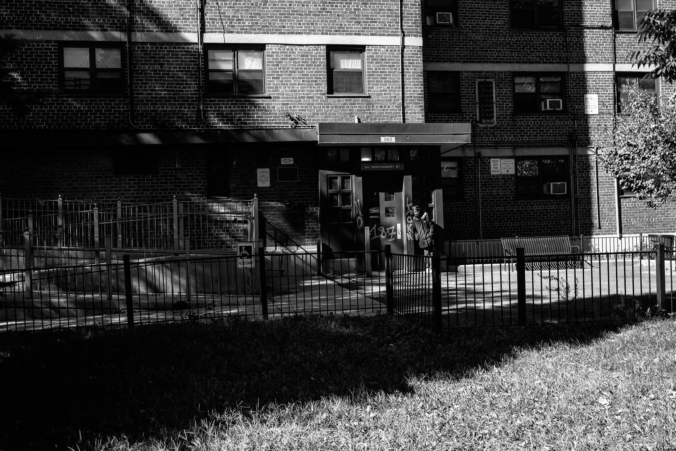 A woman stands outside of housing unit on montgomery_.jpg