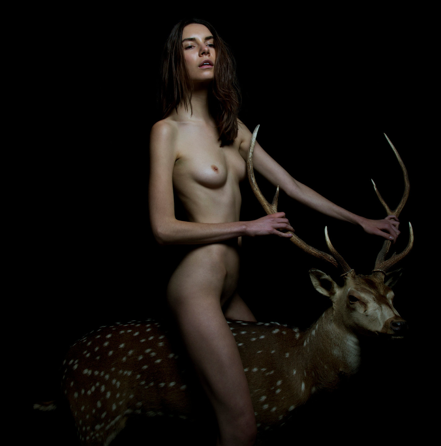 Sally as Eros riding a deer