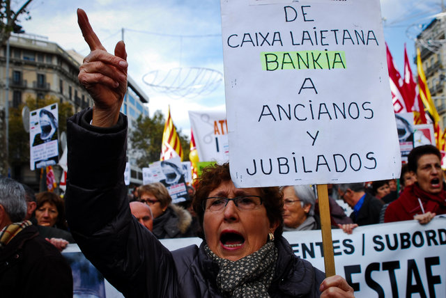 A woman shouts against the banks