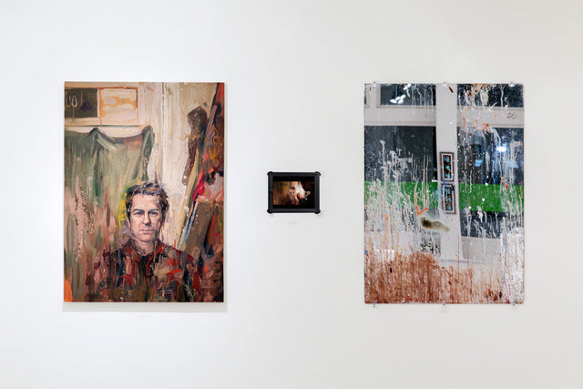 installation view: Wandzel portrait of Kuehl (left) from reflection of studio mirror (right)