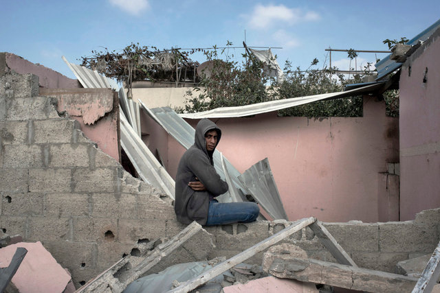Resident returned to his destroyed house in a bedouin village, Al-qaria Al-Badawia, Gaza Strip