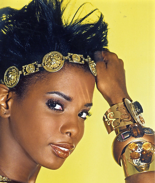 DANIELLE WILSON wears gold cuffs with an exotic twist.