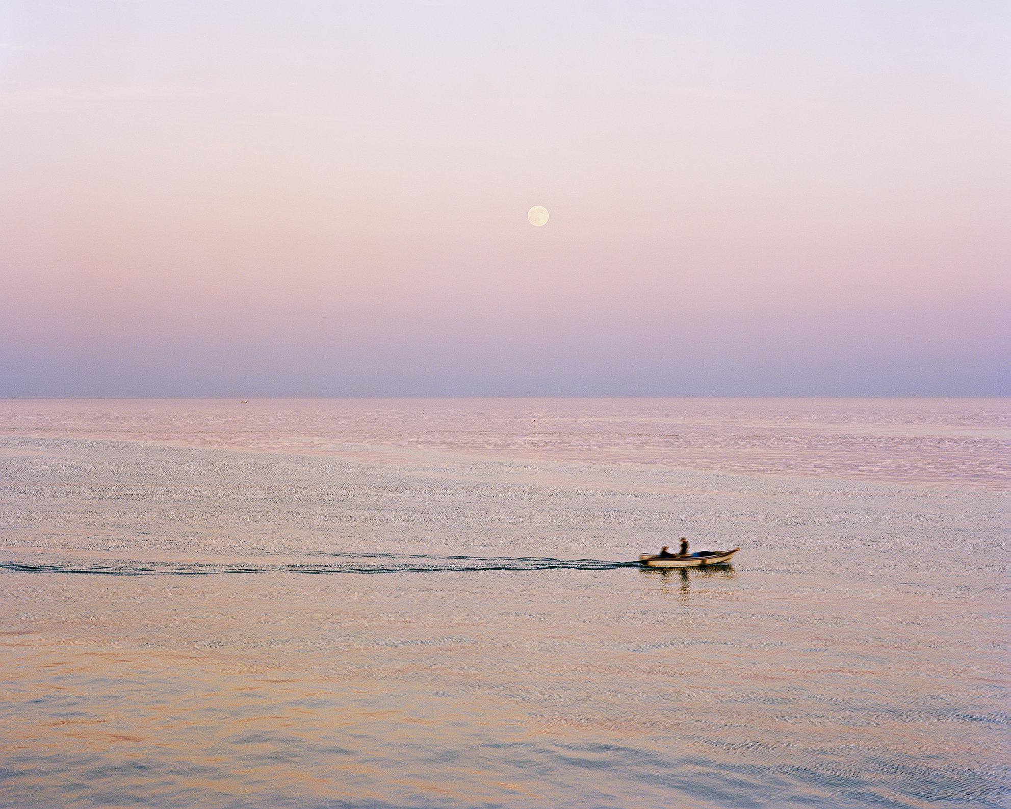 Fishermen at Dusk, off Brighton Marina.