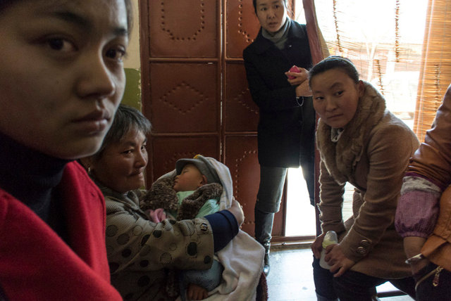 Patients inside a Traditional pharmacy, Dali, Yunnan