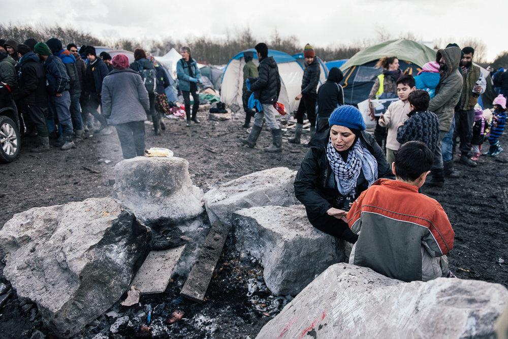 Volunteers looking after children.